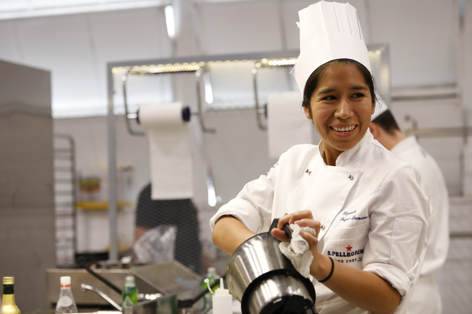 Elizabeth Puquio Landeo, 2018 Global Finalist for Latin America, portrayed during the preparation of her signature dish at the 2018 S.Pellegrino Young Chef Global Final. (PRNewsfoto/S.Pellegrino)