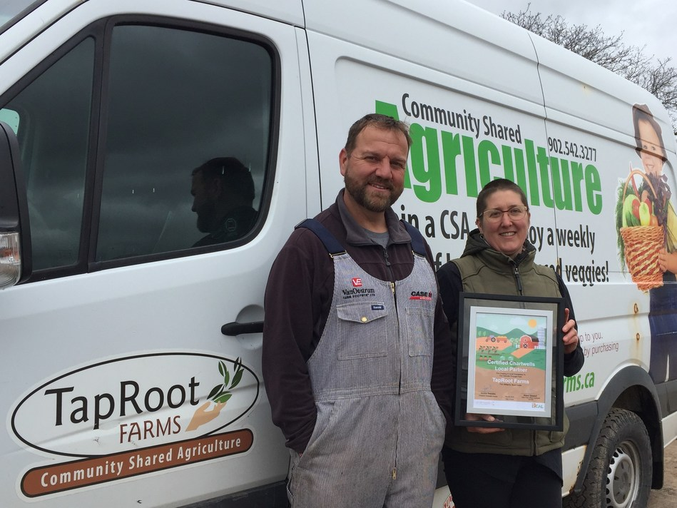 1st Buy Local certified partners: Patricia Bishop and Josh Oulton from TapRoot Farms, Port Williams, NS (CNW Group/Chartwells Canada)