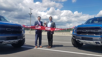 Jonathan Wahba, CP Vice-President, Sales and Marketing Intermodal and Automotive and Tim Quesnel, Ford Canada Regional Sales Manager – Vehicle Sales Western Market Area cut the ribbon at the new Vancouver Auto Compound. (CNW Group/Canadian Pacific)