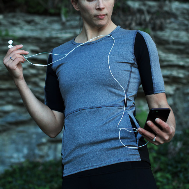 The Berryman Running top is unlike any other. Based around women ultra-marathoners who wanted the best shirt every made to help excel at long distances. This shirt features technical details such as compression arm sleeves for your phone, a loop for your headphones, and four storage pockets for your stuff.