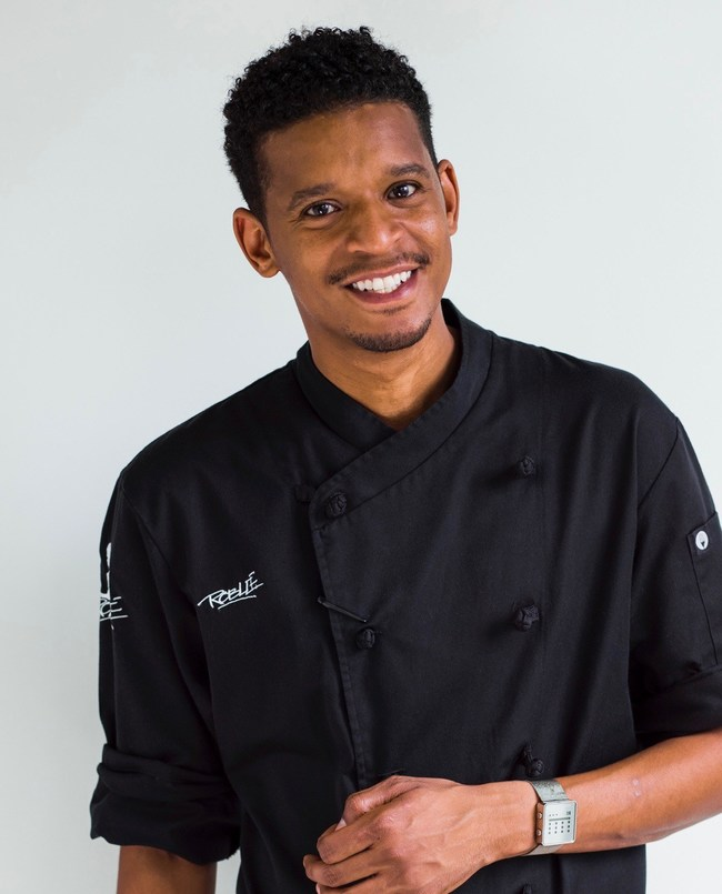 """Chef Roblé Ali, Founder and Executive Chef of Roblé & Co., and one of Brooklyn's top chefs, will begin a residency at Brooklyn's The Tillary Hotel, overseeing the food and beverage program at the Brooklyn boutique hotel. Chef Roblé has catered to such noteworthy people as President Obama, Leonardo DiCaprio, John Legend, Jack Nicholson and Michael Jackson, and the company was the subject of a Bravo docudrama, """"Chef Roblé & Co,"""" for two seasons."""