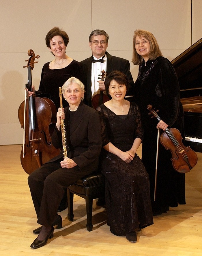The Pierrot Consort, the LIU Post chamber music faculty ensemble, are, standing l-r, Maureen Hynes, cello; Dale Stuckenbruck, violin; and Veronica Salas, viola; and seated, l-r, Susan Deaver, flute, and Heawon Kim, piano.