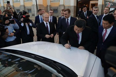 In the Front of Kremlin. China President Jinping Xi and Russian President Vladimir Putin Sign the Autographs on a Haval F7.