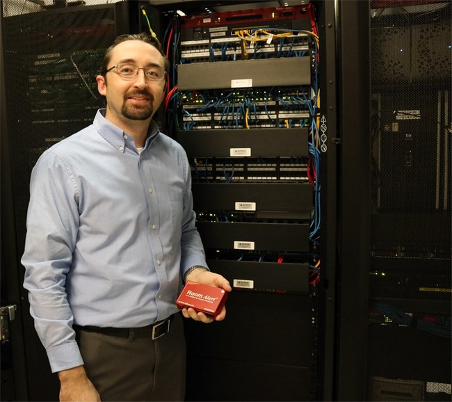 Richard Grundy displays Room Alert monitors in a local data center.