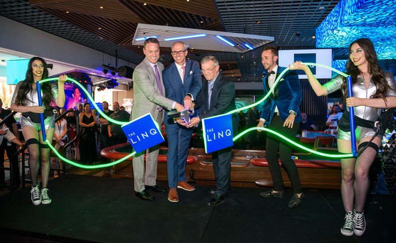 (L-R) SVP and General Manager of The LINQ Hotel + Experience, Ryan Hammer; EVP of Gaming and Interactive Entertainment, Christian Stuart; and Caesars Entertainment's CEO and President Tony Rodio cut the LED ribbon, celebrating the grand opening of RE:MATCH and The LINQ Hotel + Experience's new immersive gaming environment on Friday, June 7.