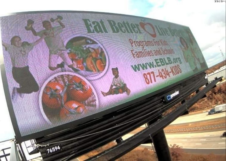 Eat Better Live Better billboard showcases the memorable vanity phone number (1-877-434-KIDS) they received from RingBoost.