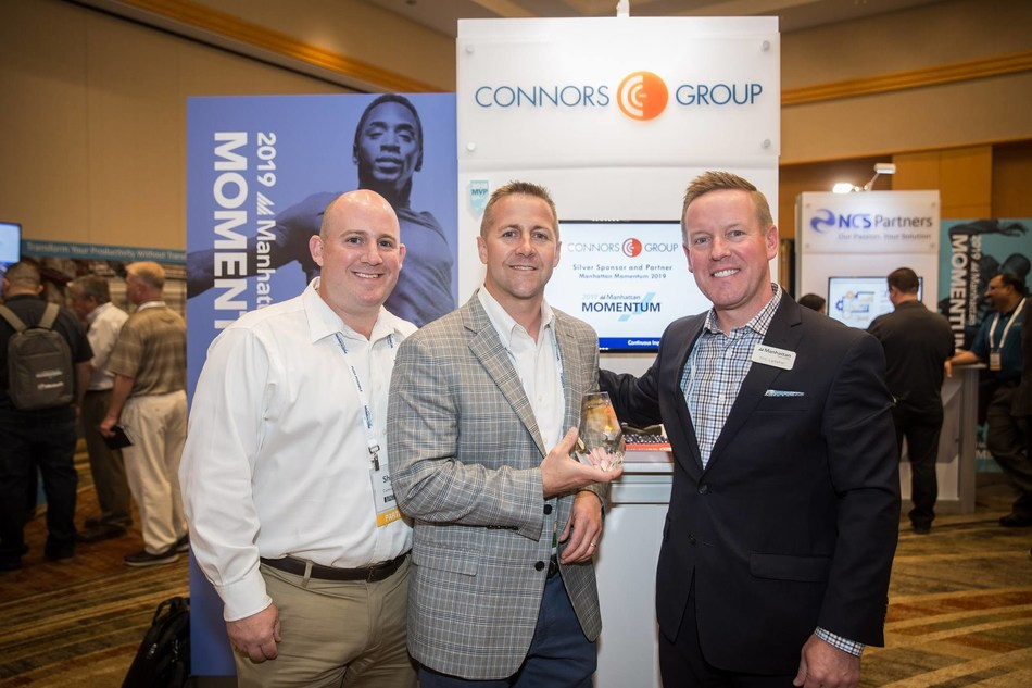 Shawn Roche (left) and Jon Huesdash (center) from Connors Group receiving the Innovator of the Year award from Eric Lamphier of Manhattan Associates at the recent Momentum conference in Phoenix, Arizona.