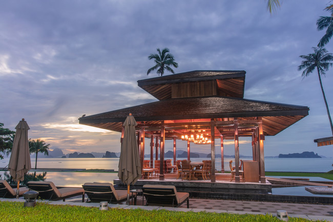 The dramatic dining room setting at ÀNI Thailand on the serene island of Koh Yao Noi - the private resort where Aaron Paul surprised his wife Lauren, flying in their closest friends to celebrate her 30th birthday.