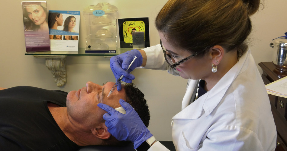 Dr. Anne Taylor, ASPS member surgeon, administers filler treatment to male patient. Male use of fillers has increased 101% since the year 2000.