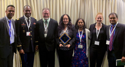 FedHealth IT Innovation 2019 Award for Blockchain initiative for US Army Medical Materiel Agency, supported by IndraSoft team. From left to right: Karthik Srinivasan, Col. Darryl McGuire (US Army MEDCOM), Eric Strattan, Olga 'Liz' Andrews (US Army MEDCOM), Hiral Patel, Nicole Hamlin, Raj Lingam.