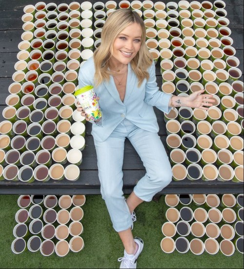 Laura Whitmore is surrounded by approx. 100 cups of tea – the number Brits drink every second - as she launches the first ever tea swap as an #acTEAvist, held by Clipper Tea. Laura is encouraging people to make every cuppa count with small swaps that make a big difference. (PRNewsfoto/Clipper)