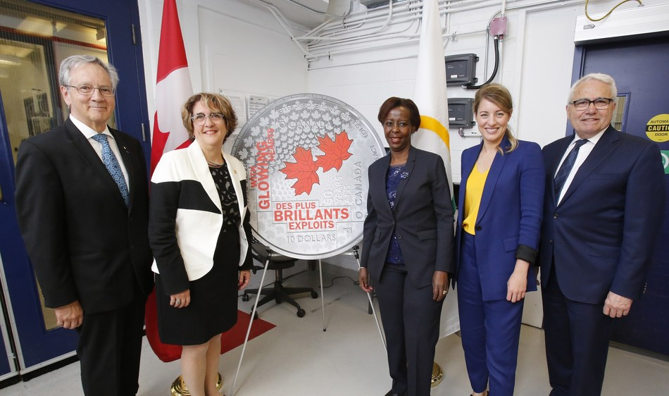 From left: Gilles Patry of the Royal Canadian Mint Board of Directors, Mint President and CEO Marie Lemay, the Secretary-General of La Francophonie Louise Mushikiwabo, the Minister of Tourism, Official Languages and La Francophonie Mélanie Joly and Official Languages Commissioner Raymond Théberge celebrate the striking of a new collector coin recognizing the 50th anniversary of the Official Languages Act at the Mint's Ottawa facility attended by and Marie Lemay (June 12, 2019). (CNW Group/Royal Canadian Mint)