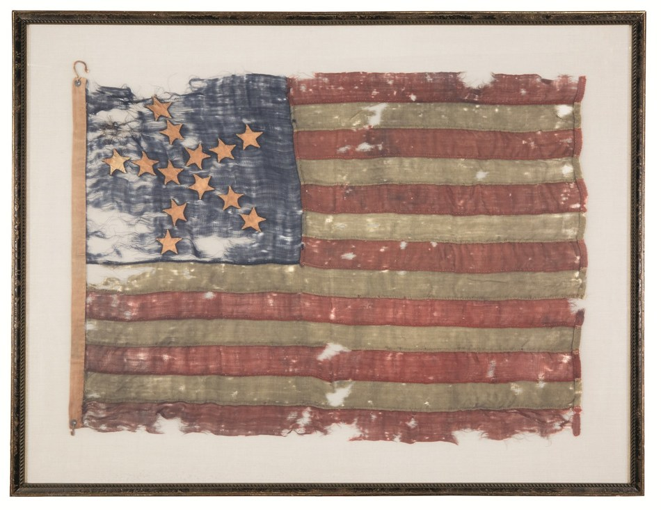 """*A 13-star American National Flag in the """"Great Luminary Pattern,"""" hand-sewn wool, late 18th century, 30 x 44 inches, framed. $15,000-25,000*"""
