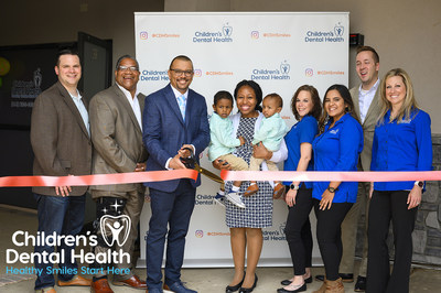 Dr. Anthony Monteiro, D.M.D. cuts the ribbon of Children's Dental Health's new pediatric dental office at 3301 Lancaster Pike in Wilmington, Delaware. Dr. Monteiro is joined by his family, members of the Children's Dental Health team, and the Delaware State Chamber of Commerce.