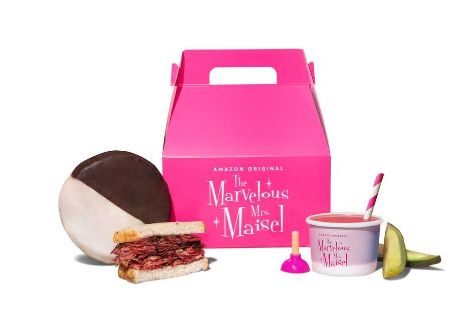 Starting June 17 through June 21, 2019, Postmates users will be able to order a marvelous and FREE giveaway in Los Angeles and New York City with The Marvelous Mrs. Maisel Meal Pack. True to the cuisine of the era and the show's Jewish roots, the meal pack will include a pastrami on rye sandwich, a pickle, a black and white cookie, and Steiner tomato juice.