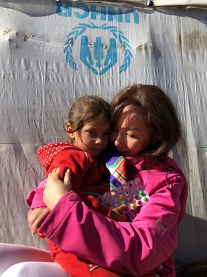 Jane Sun, the CEO of Ctrip, visited the refugee camps in the Middle East.