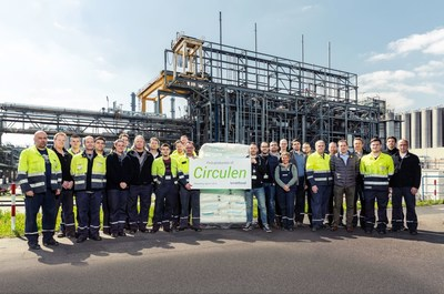 LyondellBasell production team in Wesseling, Germany shows off first batch of bio-polymer made from renewable materials. (PRNewsFoto/LyondellBasell)