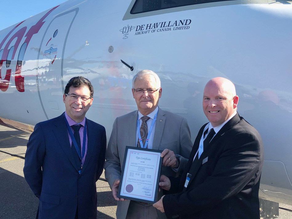 David Curtis, Chairman and CEO Longview Aviation Capital, the Honourable Marc Garneau, Minister of Transport, and Todd Young, Chief Operating Officer, De Havilland Aircraft of Canada celebrate De Havilland Canada formally receiving the Type Certificates for the entire Dash 8 aircraft program. (CNW Group/De Havilland Aircraft of Canada Limited)
