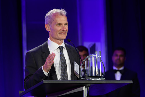 FLEXE Co-Founder and CEO, Karl Siebrecht, accepting the 2019 Entrepreneur Of The Year® Award. Photo credit: Kevin Lisota on behalf of EY.