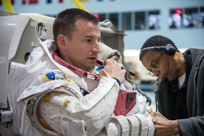 NASA astronaut Andrew Morgan prepares for spacewalk training Jan. 24, 2018, in the Neutral Buoyancy Laboratory at NASA's Johnson Space Center in Houston. Credit: NASA/James Blair