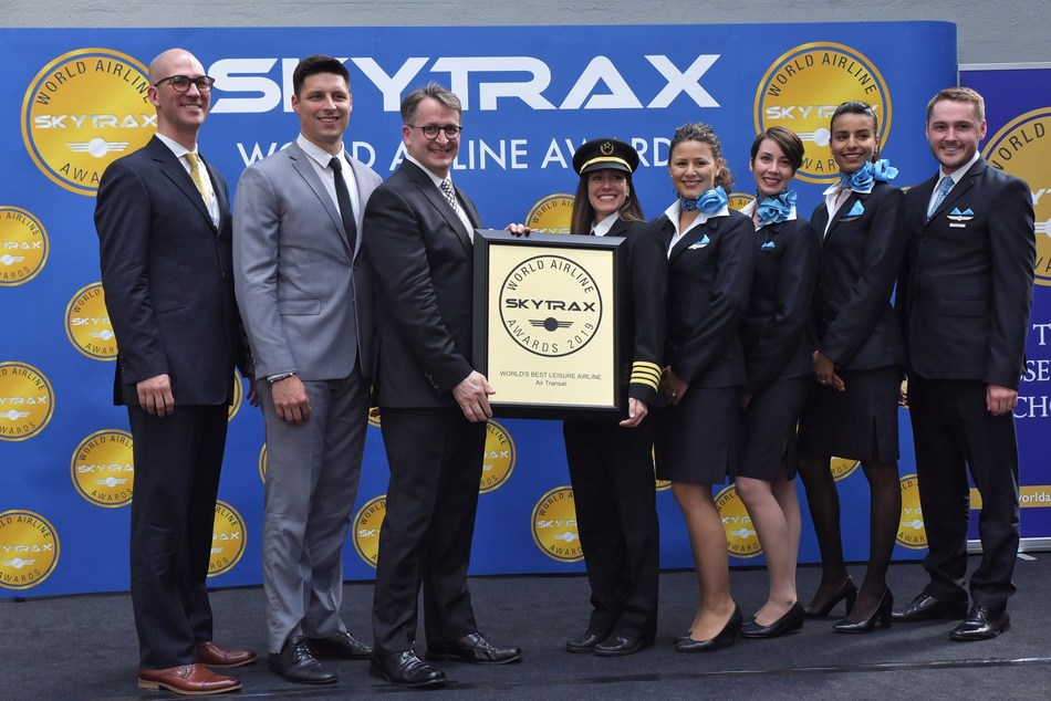 Left to right : Dave Bourdages, Vice-President, In-Flight Services and Customer Experience, Simon Rochette, Manager, In-Flight Experience and commissary, Jean-François Lemay, President, Martine Olivier, Captain A330, Karina Comlekcioglu, Security Officer, Émilie Lamborelle and Hajar Hannouni, Flight Attendants, Nicolas Demers, Performance Manager, In-Flight Service (CNW Group/Transat A.T. Inc.)