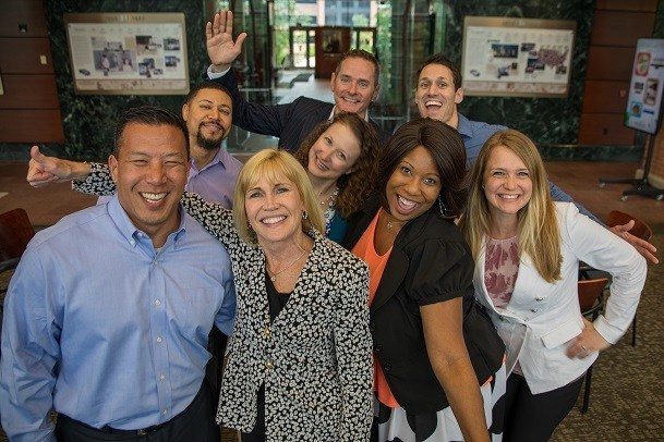 Enterprise CEO Pam Nicholson (black and white print blazer) with employees at the company's corporate headquarters in St. Louis.