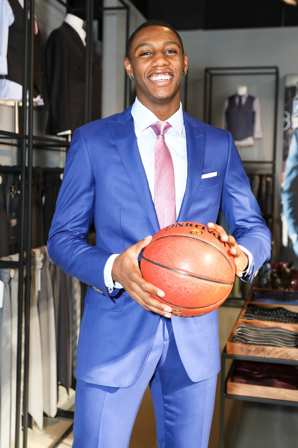 INDOCHINO's first Signature NBA Athlete, RJ Barrett, will be running a series of campaigns, including an exclusive RJ Barrett collection of custom apparel and customizations handpicked to coincide with his 2019-2020 NBA season debut. (CNW Group/Indochino Apparel Inc.)