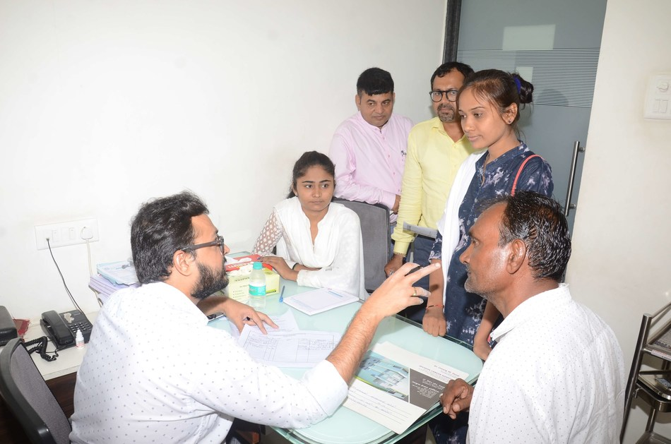 An Oncologist Doctor examining patient during the cancer camp (PRNewsfoto/SRK Knowledge Foundation)