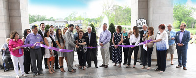 The Moceri Family along with Oakland County and Rochester Chamber of Commerce officials cut the ribbon to signify that Blossom Ridge's Inspired Senior Living is officially open.