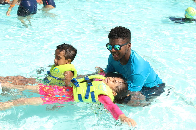 A young swimmer at Wild Wadi Waterpark in Dubai works on the back float with instructor Fahad Jamal during Thursday's World's Largest Swimming Lesson. The global event took place in 29 countries on six continents to build awareness about drowning prevention.
