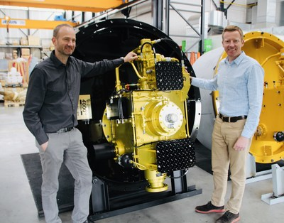 Erik Veth (left) and Tim Batten (right) traveled to Greece to deliver a special edition, golden thruster, the 4,000th thruster produced by Veth Propulsion since the first was built in 1986.