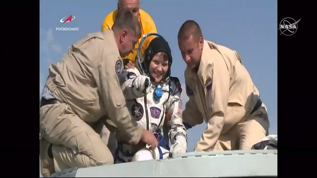 NASA astronaut Anne McClain is assisted out of the Soyuz MS-11 that returned her and crewmates Oleg Kononenko of the Russian space agency Roscosmos and David Saint-Jacques of the Canadian Space Agency back to Earth on June 24, 2019, after 204 days aboard the International Space Station. Credits: NASA Television