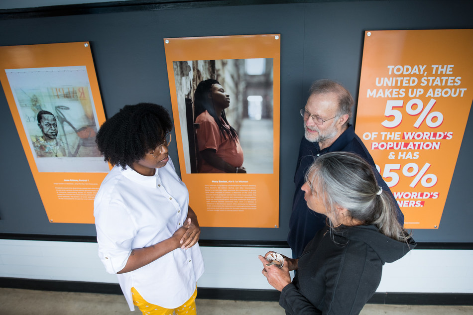 (From left) Artist Mary Baxter of Philadelphia, Pa. talks with Ben & Jerry's Co-Founder Jerry Greenfield and Sherry Packman of Starksboro, Vt., while viewing the newly-opened Art for Justice exhibit at the Ben & Jerry's factory on Tuesday, June 25, 2019 in Waterbury, Vt. The exhibit highlights the need for criminal justice reform and features artwork by formerly-incarcerated artists, including Baxter. (Andy Duback/AP Images for Ben & Jerry's)