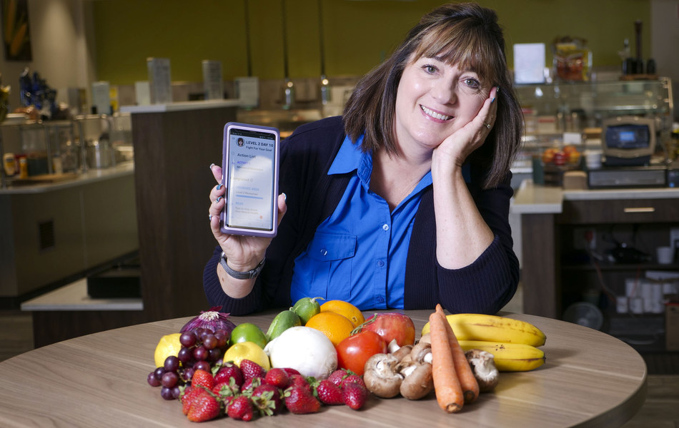 """Veggies and fruits galore are the reason for Blue Shield of California employee Kim Stotler's  smile. """"I feel really good for the first time in years,"""" says Stotler, who lost nearly 20 pounds in the first month of the nonprofit health plan's new Wellvolution digital lifestyle medicine program. The clinically proven health digital platform gives participating members access to clinically proven health-management resources – the largest in the industry - at no extra cost."""