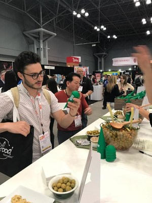 Food professionals exploring the 'Have an Olive Day' stand at the 'Summer Fancy Food Show'.