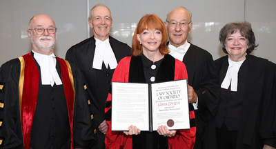 The Hon. Gloria Epstein (middle) received an honorary LLD from the Law Society of Ontario at the June 25 morning Call to the Bar ceremony in Toronto. She was honoured for her dedication and contributions to the legal profession and community at large. Shown here congratulating her are (l-r): LSO Treasurer Malcolm Mercer; The Hon. George R. Strathy, Chief Justice of Ontario; LSO lay bencher Seymour Epstein; and Emeritus Treasurer Janet Minor. (CNW Group/The Law Society of Ontario)