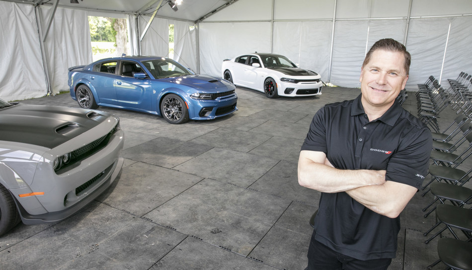 Dodge//SRT Literally Expands High-Performance 2020 Dodge Charger SRT Hellcat and Scat Pack With New Widebody Models. Tim Kuniskis, Head of Passenger Cars – Dodge, SRT, Chrysler and FIAT, FCA – North America, unveiled the new 2020 Dodge Charger SRT Hellcat Widebody (center) and 2020 Dodge Charger Scat Pack Widebody (right) at FCA's Chelsea Proving Grounds on June 27, 2019.  Dodge Charger Hellcat Widebody is the most powerful and fastest mass-produced sedan in the world. Dodge//SRT also displayed the Challenger SRT Hellcat Widebody (left) during the annual What's New event.