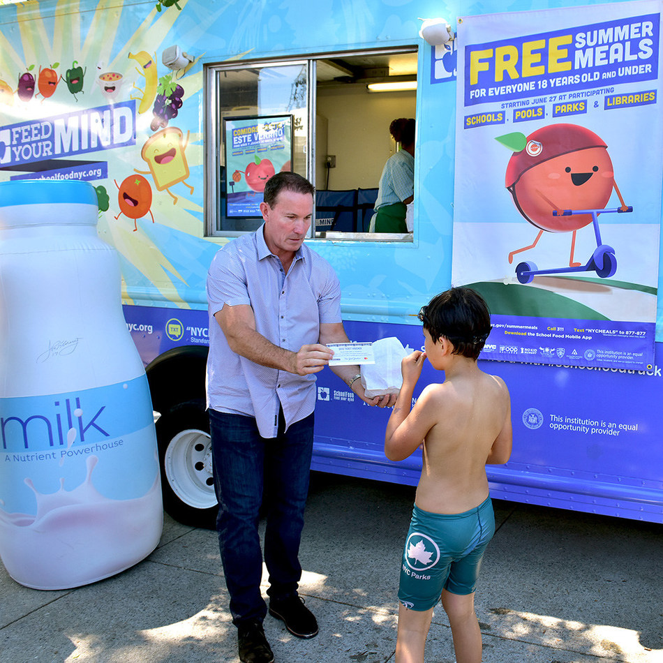Former New York Yankees catcher and current YES Network broadcaster John Flaherty was on hand to distribute lunch at the NYC Summer Meals kickoff on June 26. FREE Summer Meals are available statewide to all children 18 and under. No registration or ID is required.