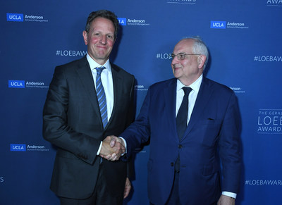 Timothy Geithner, 75th U.S. Secretary of the Treasury, congratulates Martin Wolf of the Financial Times, 2019 Loeb Lifetime Achievement Award, after presenting him with his award.