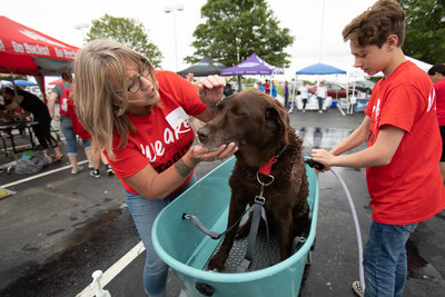 Honda associates joined with a local dealership, Honda Marysville, to host a pet expo, which included pet vendors and animal adoptions and a dog washing station.