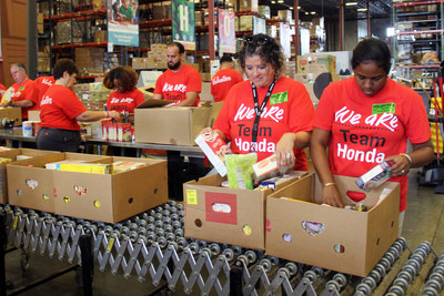Week of Service volunteers from Classic Honda in Orlanda, Fla. helped sort food at a local food pantry.