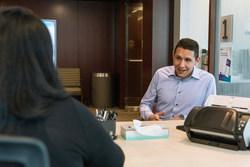 Patient coordinator registering Guillermo Muñoz Küster in the new space. (PRNewsfoto/Northwestern Memorial Hospital)