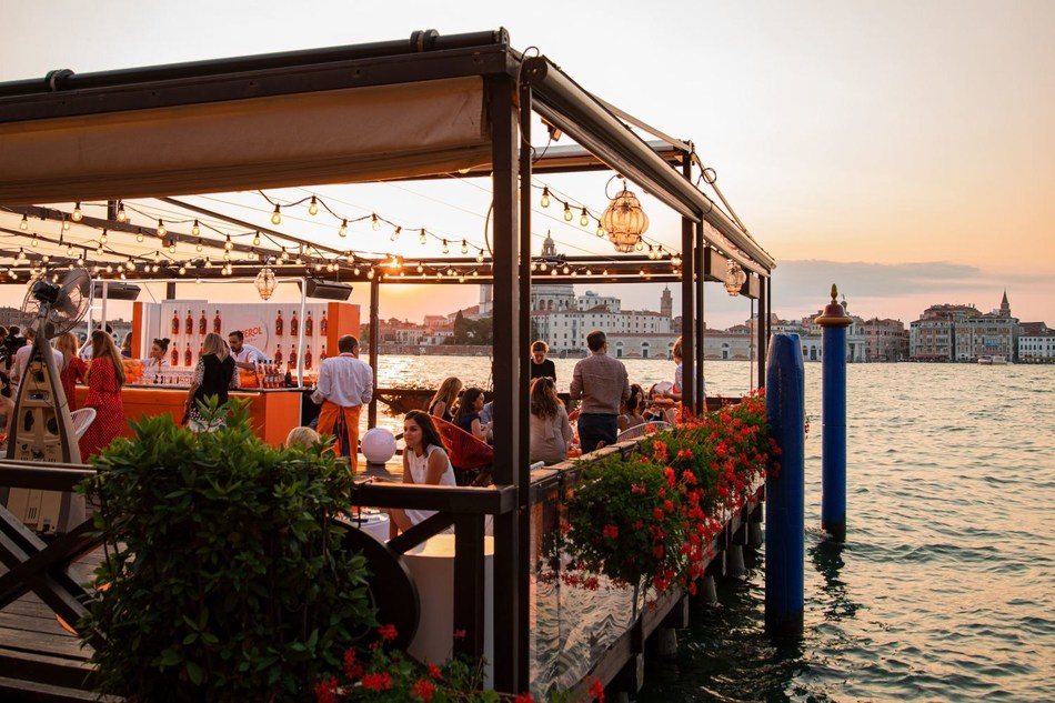 Aperol celebrates its 100th Birthday in Venice, bringing guests from around the world together to toast to the iconic orange aperitif (PRNewsfoto/Aperol)