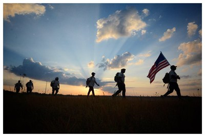 Veterans and supporters kept the memory of Army Sgt. Travis Cooper alive during a 22-mile hike in Mississippi.