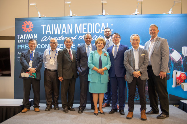 Taiwan Presenters pose for the ceremonial photo after introducing new cost saving medical devices to a crowded room of health professionals and executives looking for advanced technology to cut healthcare costs.