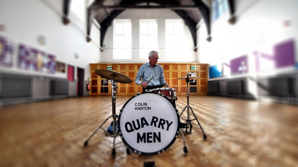 Original Quarry Men drummer Colin Hanton and his drums at St. Peter's Church Hall in Liverpool, the location where John Lennon met Paul McCartney in 1957. (PRNewsfoto/PreFab Four Productions, LLC)