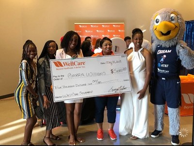 On June 1, Gierra Williams received a WellCare of Georgia Scholarship during an Atlanta Dream WNBA game.