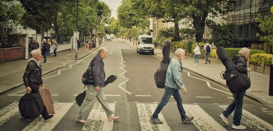 Crossing Abbey Road. From left:  Colin Hanton, Chas Newby, Rod Davis and Len Garry. (PRNewsfoto/PreFab Four Productions, LLC)