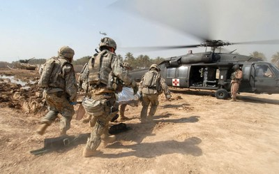 U.S. Soldiers quickly load a wounded warfighter onto a UH-60