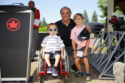 From left to right: Kaleb; Calin Rovinescu, Honorary Chair and President and CEO of Air Canada; Stone (CNW Group/Air Canada Foundation)